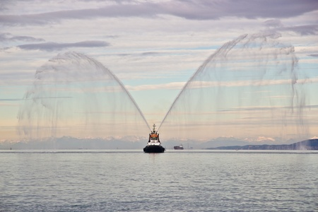 Tug boat in action during a public event in the Gulf of Trieste, Italy