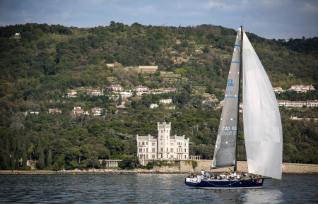barcolana: sailboat during a race in the Gulf of Trieste with Miramare castle during Barcolana 2012