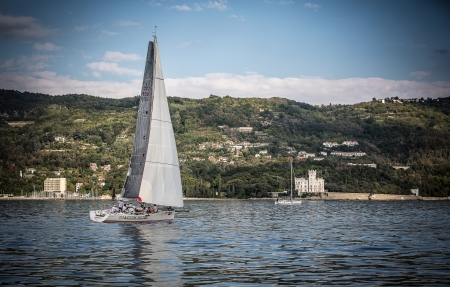 sailboat during a race in the Gulf of Trieste with Miramare castle during Barcolana 2012 Stock Photo - 15838453