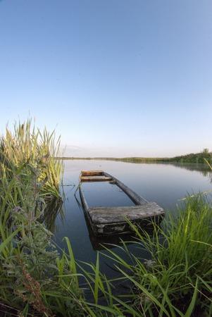 sunken: Old sunken wooden boat on the lake europe, neglected, landscape
