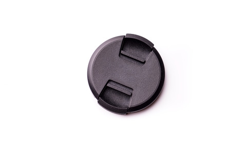 Black camera lens cover isolated on white Foto de archivo