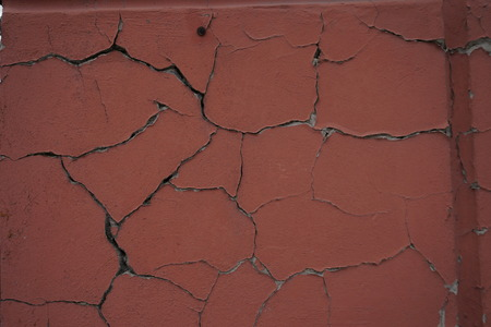 cracked: cracked stucco texture cracked brown retro textured Stock Photo