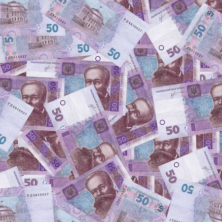 unc: lot of fifty Ukrainian hryvnia currency isolated on white