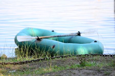 punting: Inflatable boat anchored on the pebble beach. Stock Photo