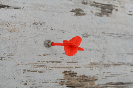 bar magnet: Magnetic darts arrow over a white wood Stock Photo