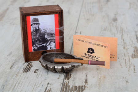 cheroot: Ashtray made of f 1 grenade-style trench art vintage background. on wooden table. Stock Photo
