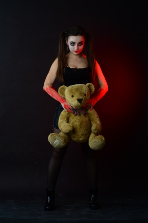 psychopath: close up of a scary looking female clown