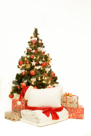 Decorated Christmas tree and gifts on white background Stock Photo