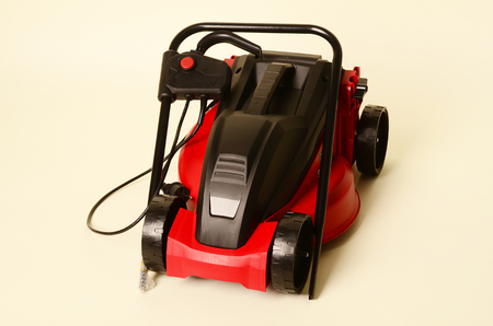 Lawnmower Isolated on White Background. Gas Lawn Mower. Red Grass-Cutter. Garden Equipment. Garden Power Tools.