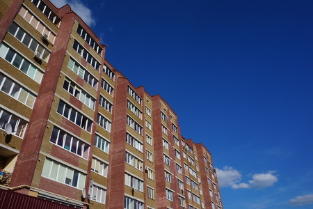 Facade of a multi-storey building. Fragment. Stock Photo
