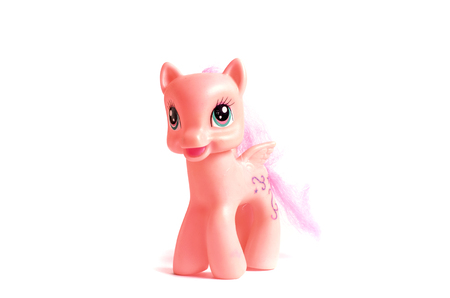 weathered: Pink toy pony with wings isolated on a white background.