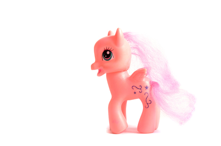 wooden horse: Pink toy pony with wings isolated on a white background.
