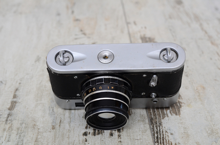 Illustrative Editorial old soviet film camera - 3 with lens - 26M, isolated on white background. Soviet reflex camera