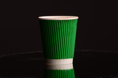 Paper coffee cup in coffee shop