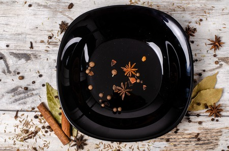 spice black plate wooden table