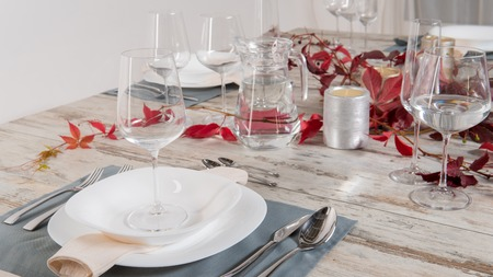 white plate table setting on wooden table