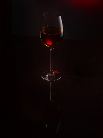 Wine pouring into a glass, studio lighting
