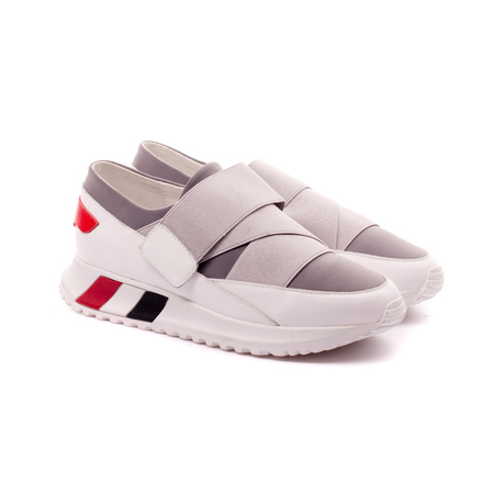 pair of sports women's sneakers, isolate on a white background Foto de archivo