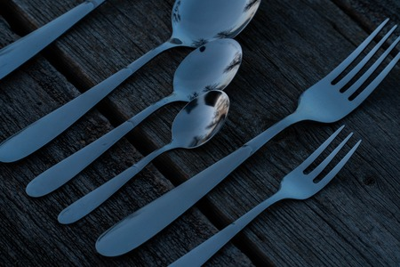 knife and fork on wooden background. Cutlery on wooden