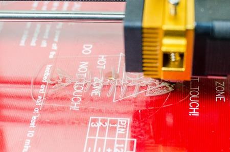 Modern 3D printer printing figure close-up macro.