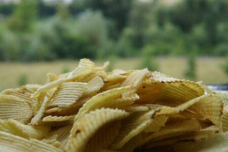 background corrugated golden chips with texture.