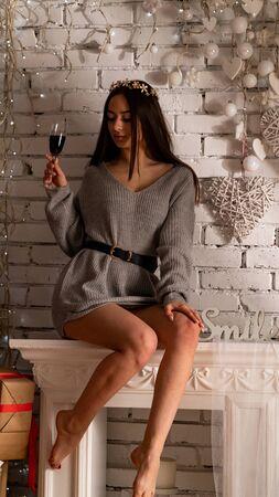 beautiful sexy girl, posing a short gray dress