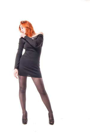 young woman in tight black dress on white background Foto de archivo