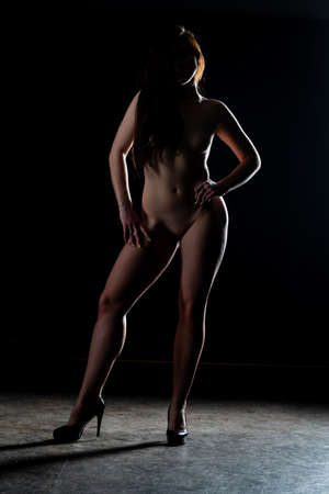 Sexy woman naked body. Nude sensual woman erotic buttocks back isolated on black