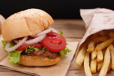 hamburger and french fries on wooden background