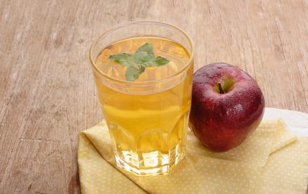 Apple juice and apples on wooden table. Selective focus Reklamní fotografie