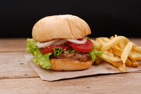hamburger and french fries on wooden background Reklamní fotografie