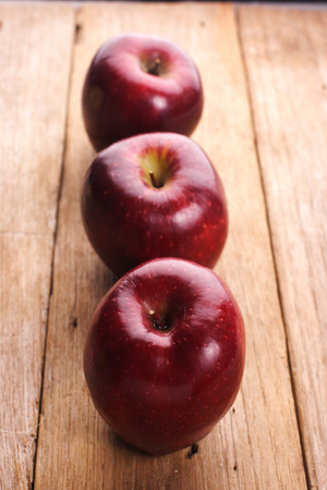 Apples on wooden table. Selective focus