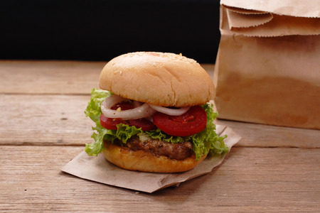 Hamburgers on wooden background Reklamní fotografie