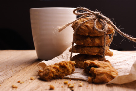 Cookie and milk on wooden background