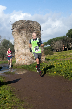 epiphany: Athletes competing in Marathon of the Epiphany in Parco Degli  acquedotti, Rome, Italy Editorial