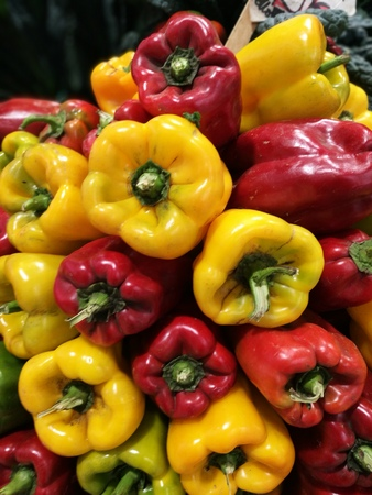 Red and Green bell peppers at a farmers market