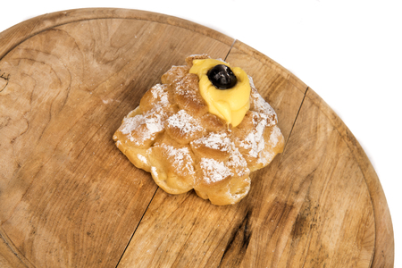 Saint Josephs Zeppole composition in display on a wooden plate