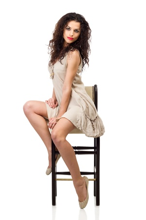 model nice: Portrait of a beautiful brunette in linen dress with red lips isolated on white