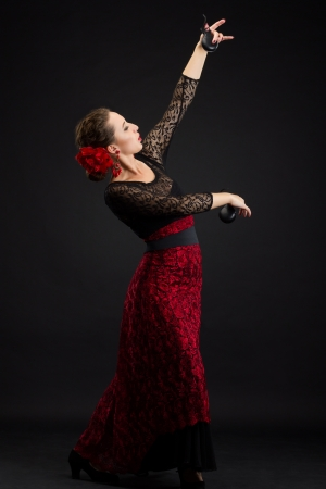 Flamenco dancer in black and red dress with castanets photo