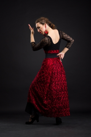 Flamenco dancer in black and red dress with red earrings photo