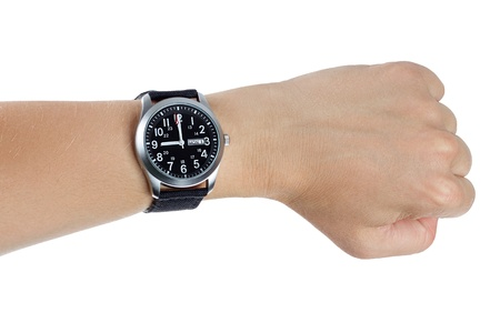 A hand wearing a black wrist watch with black textile strap over a white background photo