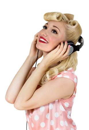 Portrait of beautiful blonde girl listening to music  Retro pin-up style photo