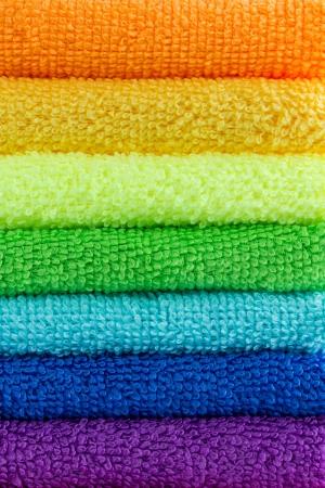 orange washcloth: stack of colorful towels Stock Photo