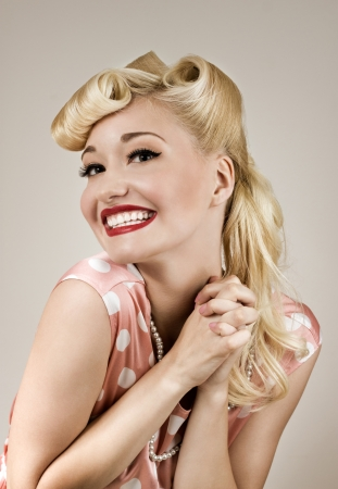 Retro style portrait of young happy woman