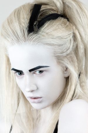 Portrait of mysterious albino woman with black eyebrows photo