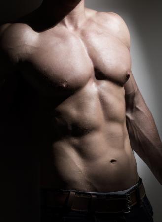 Young muscular man torso photo
