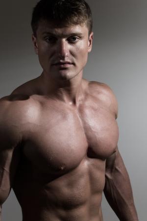 Portrait of young handsome bodybuilder photo