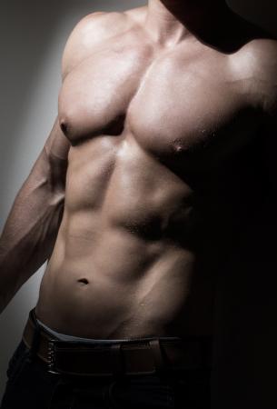 Young muscular man s torso photo