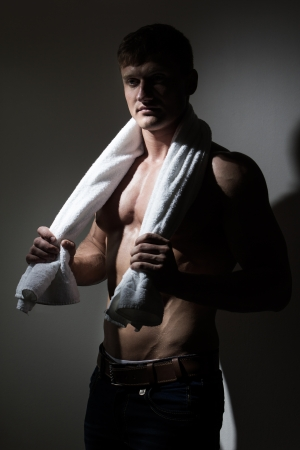 Young handsome man with white towel over his neck photo