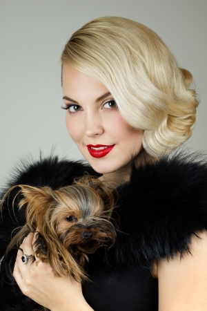 Retro portrait of a beautiful woman holding Yorkshire terrier photo